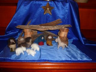 Dry felted nativty scene on blue silk background