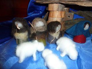 Three felt nativity set shepperds with their fleecey sheep