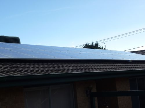 two rows of solar panels running the length of the roof